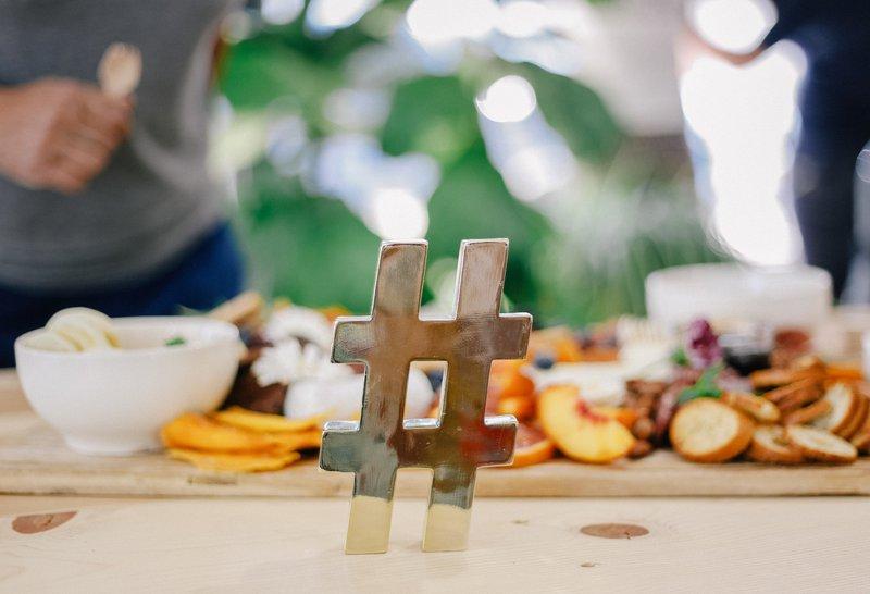 hashtag table decoration. Photographer: Allie Smith   Source: Unsplash