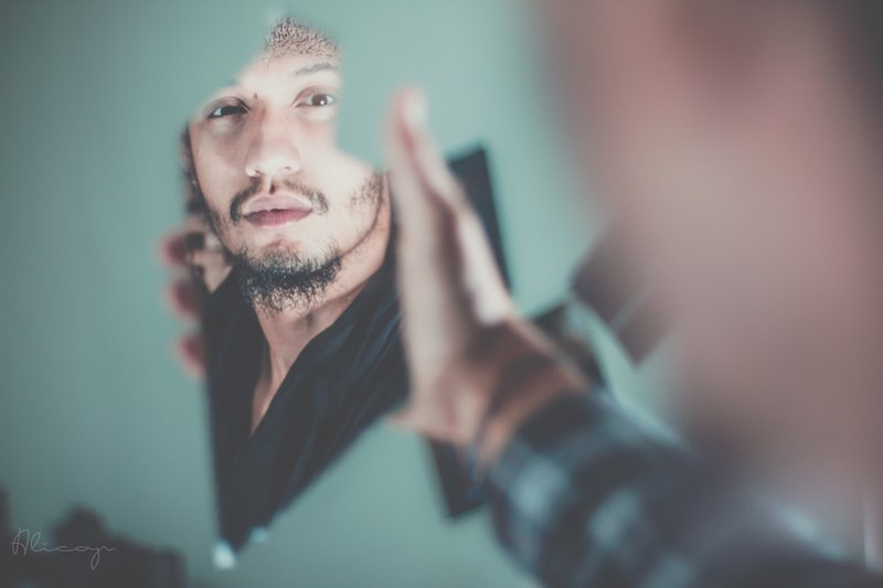 Guy looking at fraction of face through shard of mirror || Photographer: Fares Hamouche | Source: Unsplash